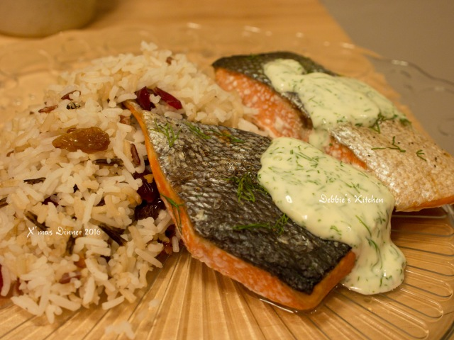 Baked sockeye salmon with creamy dill sauce Wild Rice Pilaf with Toasted Walnuts and Dried Cranberries